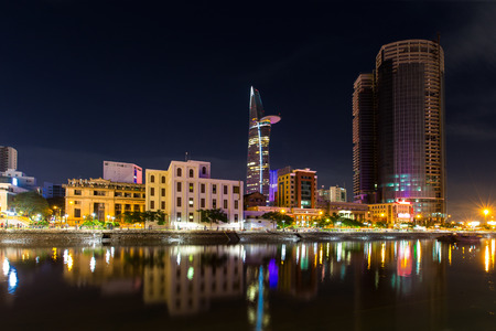 duskiness: Ho Chi Minh City, Vietnam - September 9 2014 : Night view of high building on Tau Hu canal at Ho Chi Minh City ( Saigon ), Vietnam