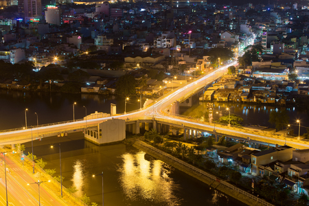 Ho Chi Minh City, Vietnam - December 14 2014: night view of Y character bridge at Ho Chi Minh Riverside with Ben Nghe or Tau Hu canal Editorial