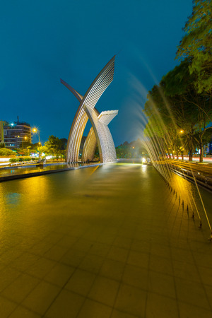 Ho Chi Minh City, Vietnam - December 13 2014: night view Metal Sculpture or peaceful monument, welcome statue at Hoang Van Thu Park on Truong Son street from Tan Son Nhat airport to downtown Ho Chi Minh City, Vietnam . Editorial