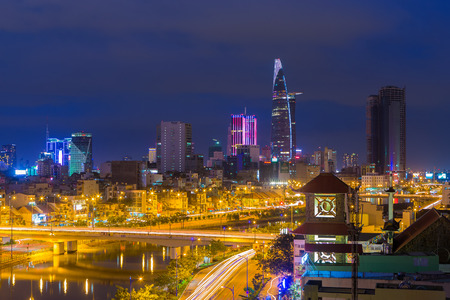 Ho Chi Minh City, Vietnam - December 13 13 2014: Ho Chi Minh Riverside cityscape night view with Ben Nghe or Tau Hu canal and calmet Bridge