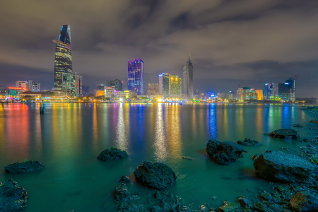 runnel: Ho Chi Minh City, Vietnam - December 19 2014 : cityscape ( night view ) of Saigon river at downtown ( center ) of ho chi minh city, Vietnam in sunrise or sunset