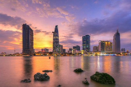 runnel: Ho Chi Minh City, Vietnam - December19 2014 : cityscape ( night view ) of Saigon river at downtown ( center ) of ho chi minh city, Vietnam in sunrise or sunset
