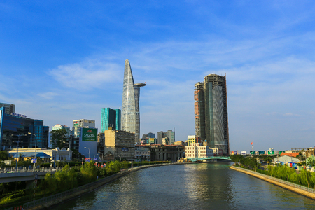 Ho Chi Minh City, Vietnam - March 08 2015 : view of Tau Hu canal and Bitexco finance building in Hochiminh city, Vietnam on December 16, 2013. It is lotus shape and one of the highest building in Vietnam.