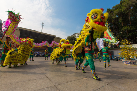 overcrowded: Ho Chi Minh City, Vietnam - February 18, 2015: A show of lion or dragon dance  at Pagoda, China Town, District 5, Cho Lon to praying heathty, safety and lucky during the lunar new year.