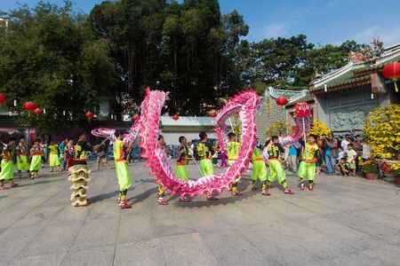 Ho Chi Minh City, Vietnam - February 18, 2015: A show of lion or dragon dance  at Pagoda, China Town, District 5, Cho Lon to praying heathty, safety and lucky during the lunar new year.