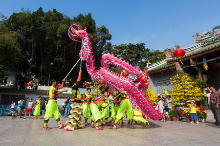 lon: Ho Chi Minh City, Vietnam - February 18, 2015: A show of lion or dragon dance  at Pagoda, China Town, District 5, Cho Lon to praying heathty, safety and lucky during the lunar new year.