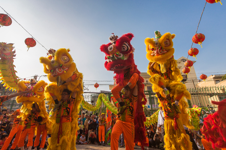birthday religious: Ho Chi Minh City, Vietnam - February 18, 2015: A show of lion or dragon dance  at Pagoda, China Town, District 5, Cho Lon to praying heathty, safety and lucky during the lunar new year.