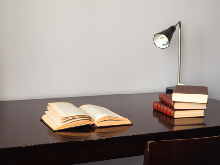 stell: Reading the book on the desk and lamp Stock Photo