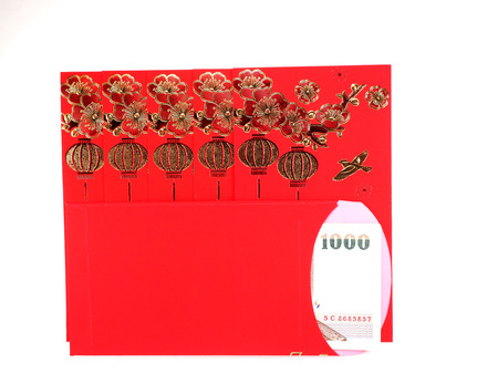 horizontal position: Red envelope with Thai money in horizontal position on the white background, Chinese New Year