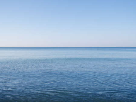Beautiful blue ocean and clear sky background
