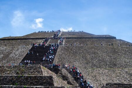 view from the bottom of the sun pyramid while people are walking to the top