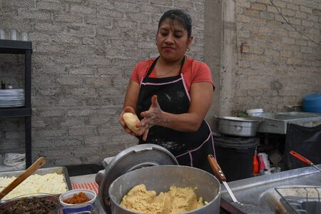 Old woman preparing a typical mexican food with her own hands