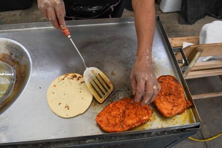 Photo of two hands preparing a typical mexican dishes