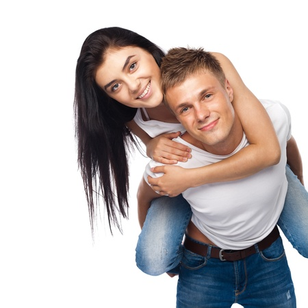 Happy young couple in casual clothing isolated on white background photo