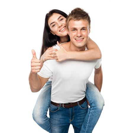 Happy young couple with his thump up, isolated on white background photo