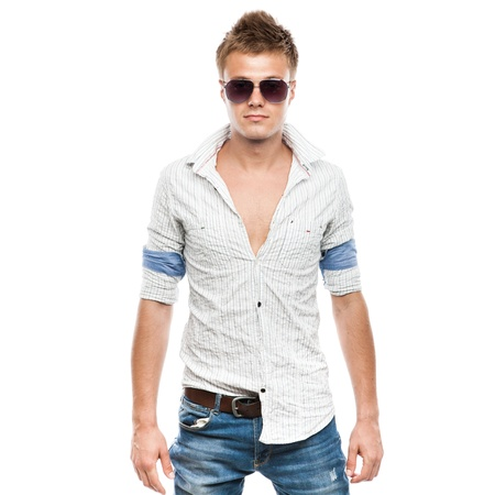 Fashion shot of an elegant young man in sunglasses, isolated on white background photo