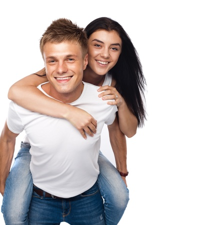 Happy young couple in casual clothing isolated on white background Stock Photo - 15212539