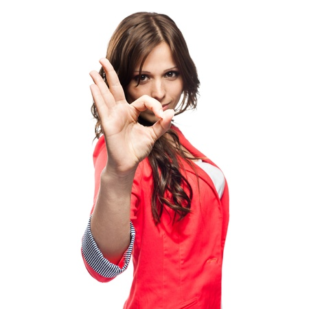 Young business woman doing Ok gesture Focus on hand