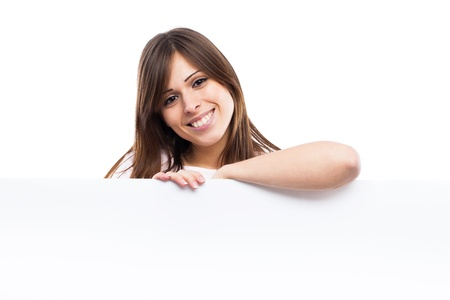Portrait of a young woman with blank billboard isolated on white background photo