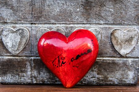 Ti amo, I love you in Italian language. Red heart on wooden background