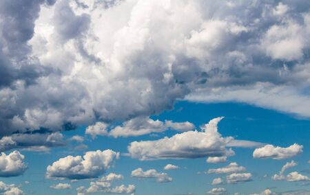 White clouds in a bright blue sky. The beauty of the nature Stock Photo