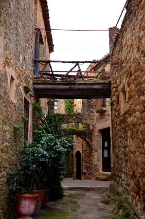 Street in the medieval town of Pals, adorned with typical local objects. Costa brava, Girona