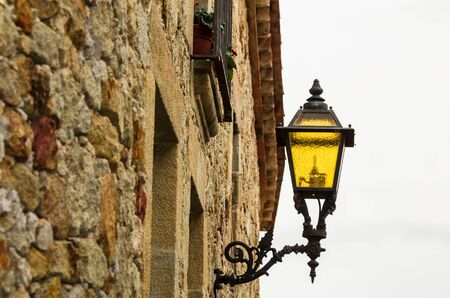 Decorative retro lamppost in the streets of the town of Pals, Girona