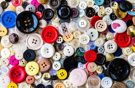 Collection of clothing buttons of various sizes and colors