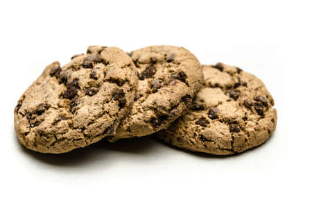 Close-up of homemade chocolate chip cookies isolated on white background.