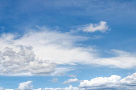 White clouds in a bright blue sky. The beauty of the nature