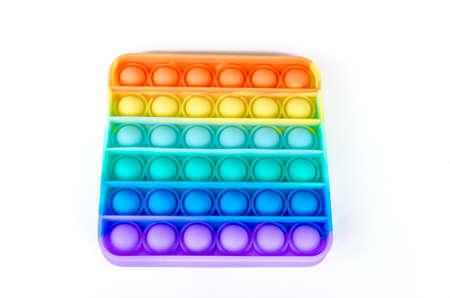 Sensory anti stress toy Pop it Fidget Toy Colorful, on white background. Copy space