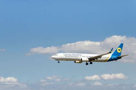 Barcelona, Spain; April 27, 2019: Boeing 737 plane of the Ukraine International airline, landing at the Josep Tarradellas airport in Barcelona-El Prat Editorial