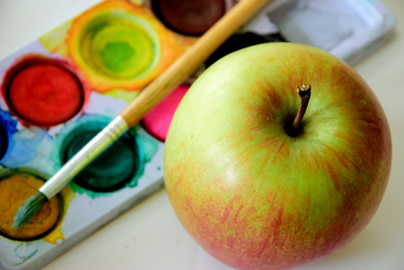 an apple and colors ready to paint, ready for a colorful watercolor