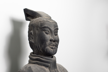 imperialism: Half profile of Chinese terracotta warrior statue face, isolated on pure white background