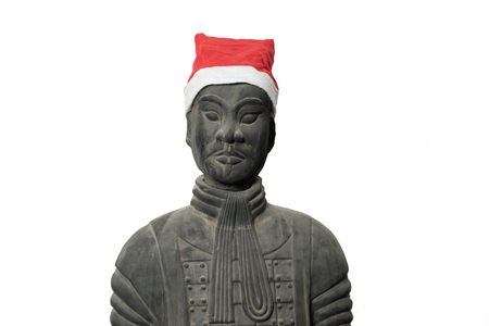 imperialism: Frontal view of Chinese terracotta warrior statue wearing a santa hat isolated on pure white background, upper body