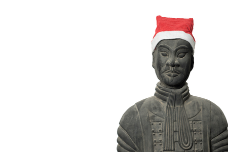 imperialism: Frontal view of Chinese terracotta warrior statue wearing a santa hat isolated on pure white background, with copy space, upper body Stock Photo