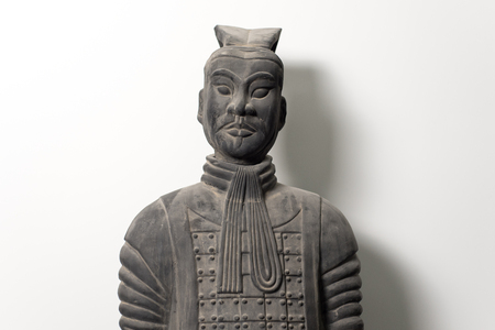 Frontal view of Chinese terracotta warrior statue, upper body, white background