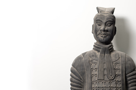 imperialism: Frontal view of Chinese terracotta warrior statue, isolated on white background, with copy space, upper body