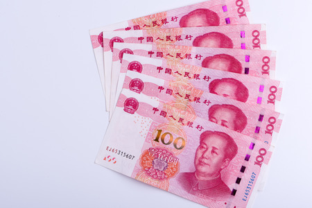 Six Chinese currency 100 RMB Yuan notes arranged as fan isolated on white background