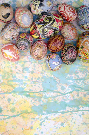 Ukrainian Easter egg, decorated with traditional Ukrainian folk designs using a wax-resist (batik) method. On the background of paint drips, splashes of watercolor creative photo