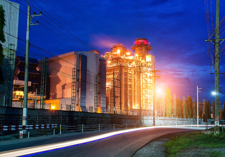 Glow light of petrochemical industry on sunset, soft focus Stock Photo