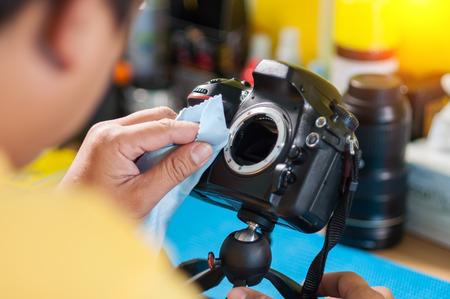 cleaning dirty camera sensor Stock Photo
