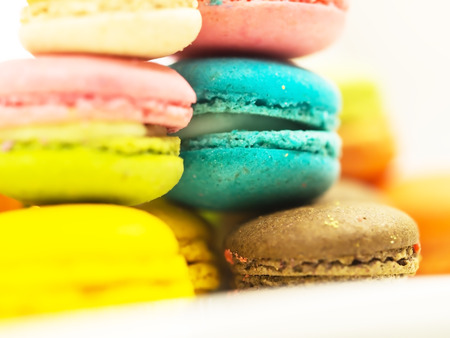 A french sweet delicacy, macaroons variety closeup.macaroon colourful texture, soft focus
