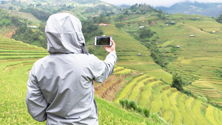 Phone tourists take scenic rice terraces Vietnam.