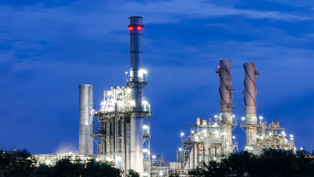 Glow light of petrochemical industry on sunset. Stock Photo