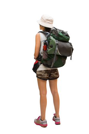 Woman hiker with backpack and sleeping bag walking, select focus Foto de archivo