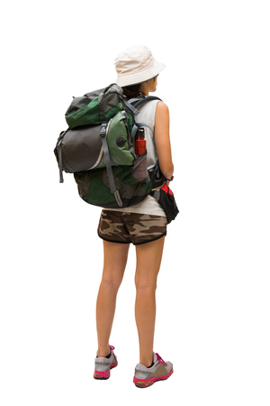 Woman hiker with backpack and sleeping bag walking, select focus Stock Photo