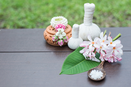 Natural Spa Ingredients herbal compress ball and herbal Ingredients for alternative medicine and relaxation Thai Spa theme with silk fabric , soft and select focus Stock Photo