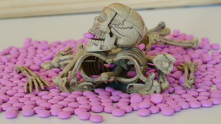 skeleton with drug on white background over dose concept. Stock Photo
