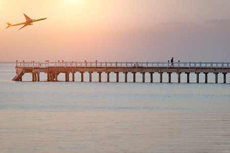 empty footbridge, long boardwalk on the lake in the evening at sunset Stock Photo